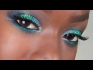 teal eye shadow blue green eye makeup on dark black skin tones sparkly