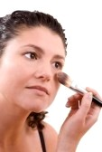 woman applying airbrush foundation with brush makeup for oily skin how to apply